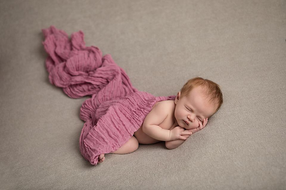 Newborn baby Eva sleeping comfortably