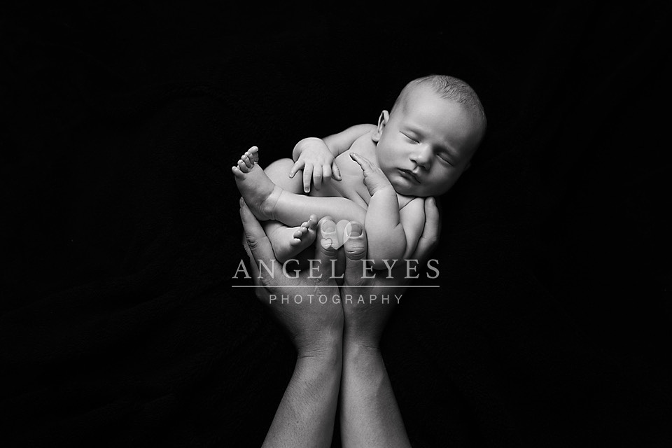 black and white in daddy's hands