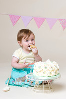 baby enjoying eating cake at cake smash - photographer taunton