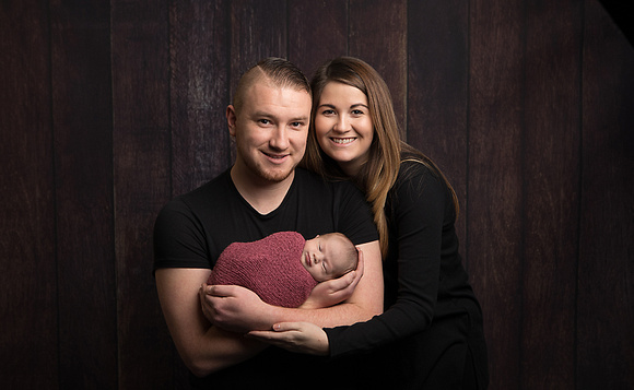 Cradled in the arms of Mummy and Daddy - baby photography somerset