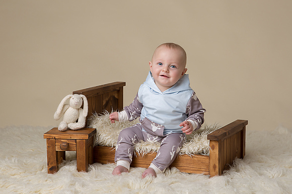 Baby sitting on bed with bunny baby photographer somerset