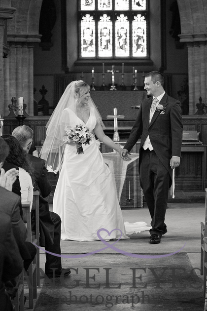 Bride and groom coming down the isle somerset photography